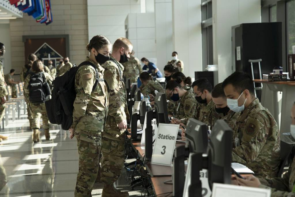 A U.S. Air Force basic trainee from the 737th Training Group provides information at the processing line to receive a COVID-19 vaccine at Wilford Hall Ambulatory Surgical Center, May 14, 2021. (Tech. Sgt. Tory Patterson/Air Force)