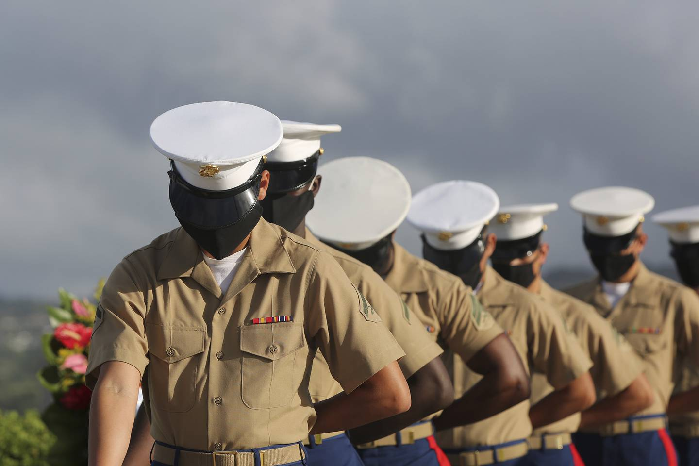Marines wearing masks pause during a prayer at a ceremony marking the attack on Pearl Harbor, Monday, Dec. 7, 2020, in Pearl Harbor, Hawaii.