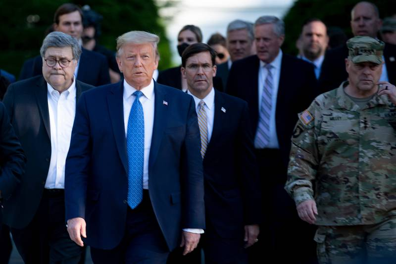 President Donald Trump walks with Attorney General William Barr, left, Secretary of Defense Mark Esper ,center, Chairman of the Joint Chiefs of Staff Gen. Mark A. Milley, right, and others from the White House to visit St. John's Church after the area was cleared of people protesting the death of George Floyd June 1, 2020, in Washington.