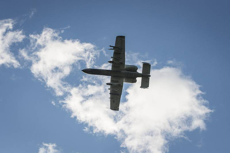 An A-10 Thunderbolt II flies over an airfield during a close-air support training mission at Eielson Air Force Base, Alaska, June 19, 2019.