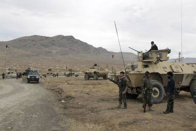 Afghan national army soldiers arrive at the site of a suicide bombing in Ghazni province west of Kabul, Afghanistan, Sunday, Nov. 29, 2020.